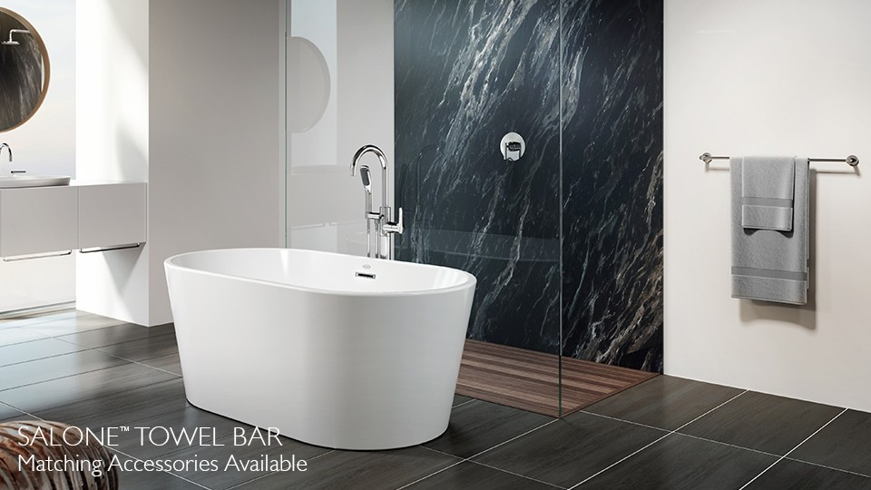 celeste freestanding bath with navy blue shower tiles and glass walls